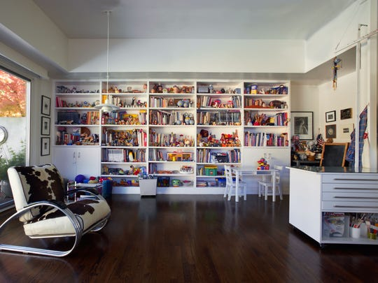 An artist's studio filled with antique toys, books and other memorabilia in a home in Marin County, California, decorated by interior designer Jan Showers. Showers says unplugging from the outside world is the best way to feel on vacation at home.
