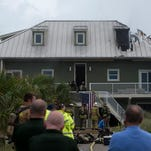 Fire fighters from Escambia County, Santa Rosa and the Federal Government respond to a firehouse fire on the 2300 block of Ariola Drive on Pensacola Beach Tuesday afternoon May 26, 2015.