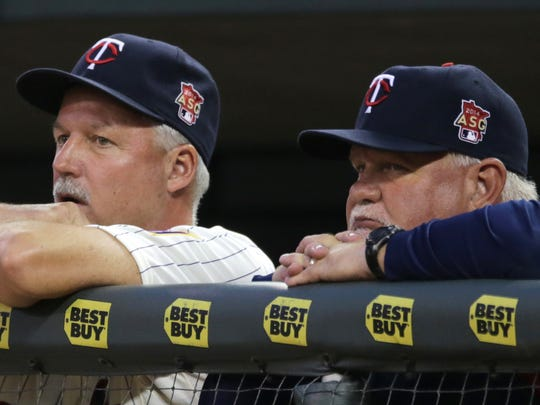 Minnesota Twins manager Ron Gardenhire, right, and pitching coach Rick Anderson watch as the Twins lose 5-1 to the Tampa Bay Rays in a baseball game, Saturday, July 19, 2014, in Minneapolis. (AP Photo/Jim Mone)