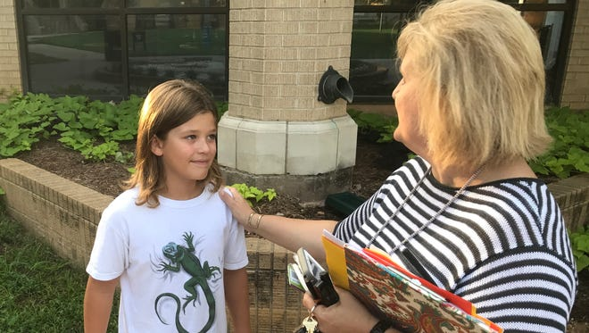 Branson Werner, incoming fifth-grade McMurry Magnet School student, meets his teacher, Marsha Hammack, at the parking lot Monday morning, Aug. 28, 2017. Branson, along with about 40 other students, returned to school by attending the expanded magnet school program, which went from one class of fifth-grade students to two this year.
