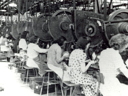 A photo from 1948 shows women working at the Remington Rand plant in Elmira.