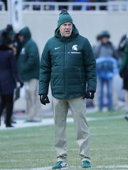 Michigan State coach Mark Dantonio watches the annual