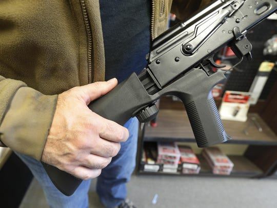 A bump stock device is installed on a AK-47 semi-automatic rifle, making it similar to a fully automatic rifle.