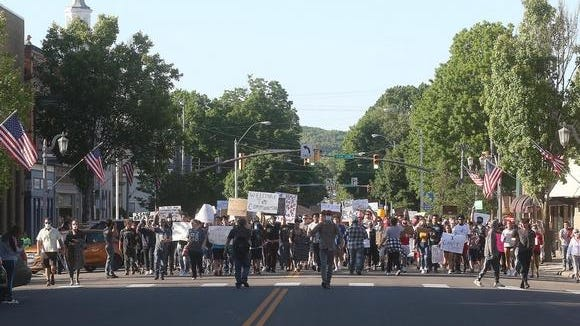 Protesters marched back to the square in New Philadelphia after a gathering at Tuscora Park.