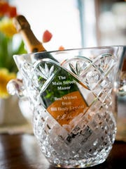 The famed crystal champagne bucket was created by master crystal artist Bill Healey of Clinton as a one-of-a-kind gift to the inn's original owners, Elinor Hichner and Dennis Lengle, in 1997, the year that Main Street Manor was founded. Healey began his career at a teenager with Waterford Crystal in Ireland.