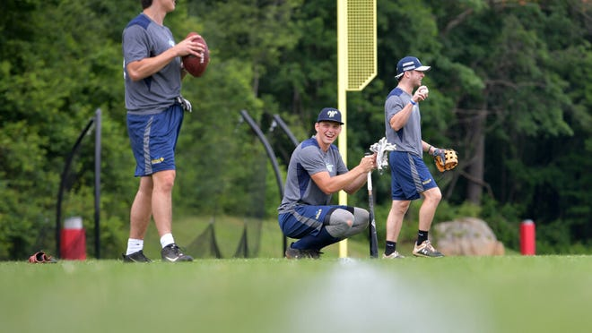 Worcester's Trevor Johnson throws a football as a warm-up tool during a practice last week at St. John's High.