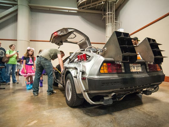 """Attendees had an opportunity to check out and take photos with a replica of the DeLorian from the """"Back to the Future"""" franchise at Lafayette's first Comic-Con at the Cajun Dome Convention Center Saturday."""