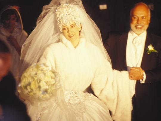 Celine Dion is all smiles with husband René Angélil on their wedding day, Dec 15, 1994.