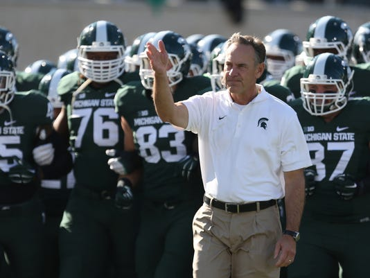 Michigan State romps over Michigan, 35-11