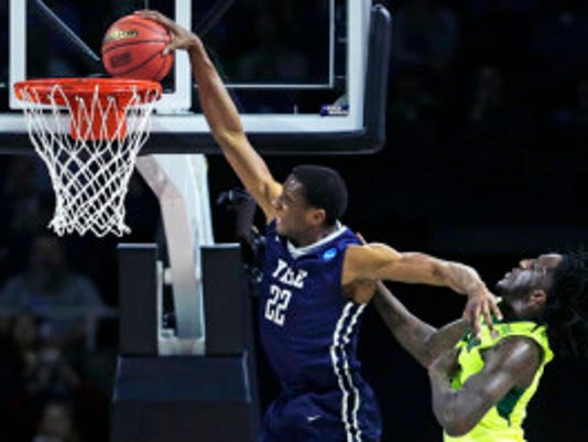 Yale forward Justin Sears (22) slams a dunk as he gets past Baylor forward Taurean Prince .