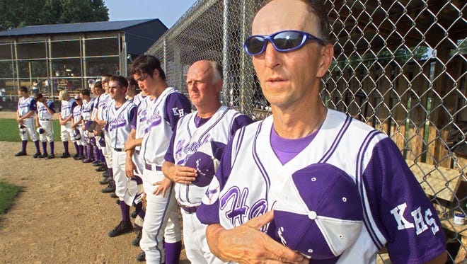 Gene Schultz and his Kee High team stand during the national anthem before a double header against Clayton Ridge in 2002.