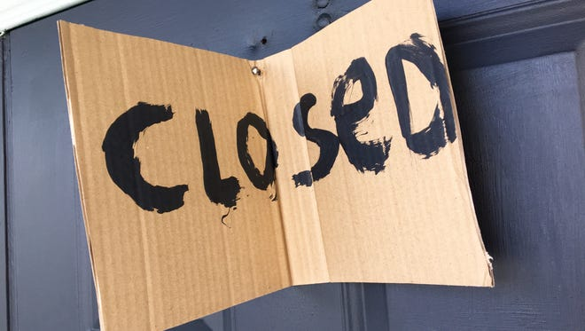 A hand-made closed sign was nailed to the front door of Sub & Pub in downtown Fort Myers Friday.