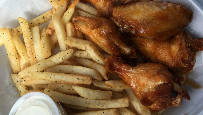 An order of seven wings and fries ($6.99) from The Wing Hut, a quick-service restaurant located in a Marathon gas station in south Fort Myers.