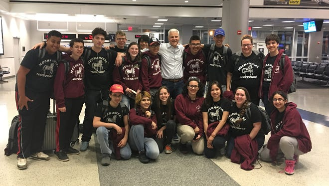 Members of Clifton High School's robotics team, the Mechanical Mustangs, traveled to Houston this week to compete in the FIRST World Championship. Don Bossi, president of FIRST, is at center.