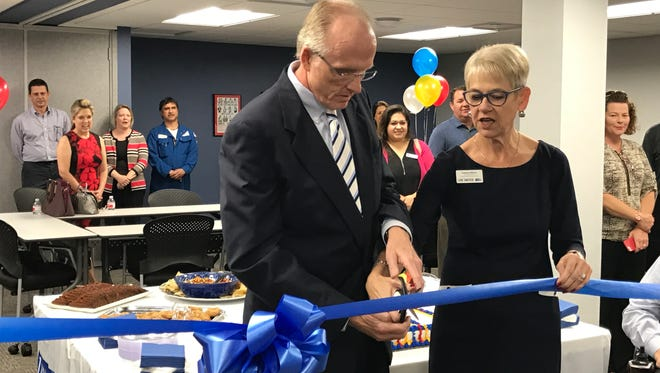 Timothy Noble, chairman of the board of directors for United Way of the Coastal Bend, and President and CEO Catrina Wilson cut a ribbon to celebrate the new office on Everhart Road.
