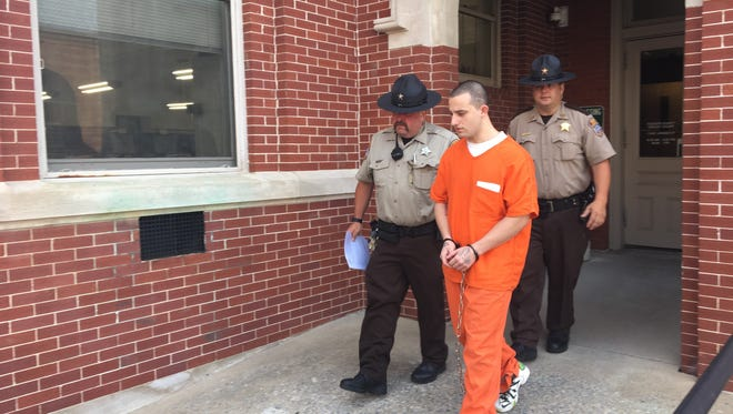 Nathaniel Hise, 19, of Stuarts Draft, is escorted out of Augusta Circuit Court on Friday, July 21, 2017, after pleading guilty to two charges related to the fatal car wreck that killed his dad last September in Hermitage.