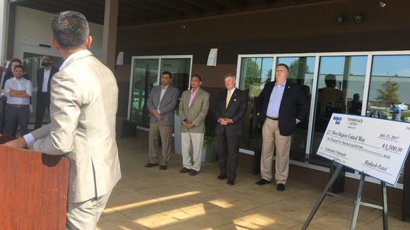 Rinkesh Patel, left, thanks investors and city leaders during a ceremony Tuesday celebrating the opening of Towneplace Suites in Eastchase.