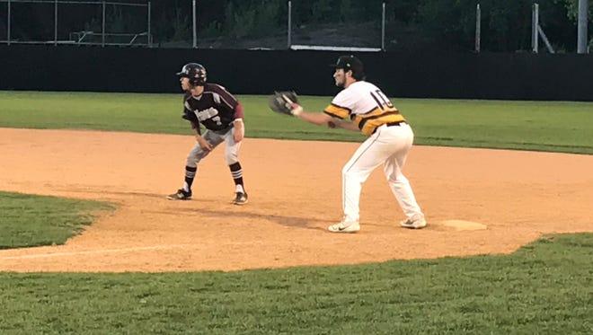 Verona's Tino Quagliata (left) leads off first base, covered by Cedar Grove's Joe Kubu (right).
