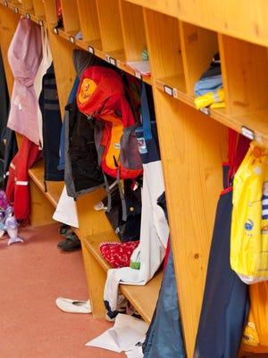 Clothes in the cloak room of a kindergarten classroom.