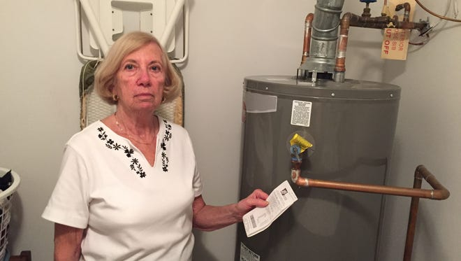 Marilyn Tucker of Toms River with her new water heater.