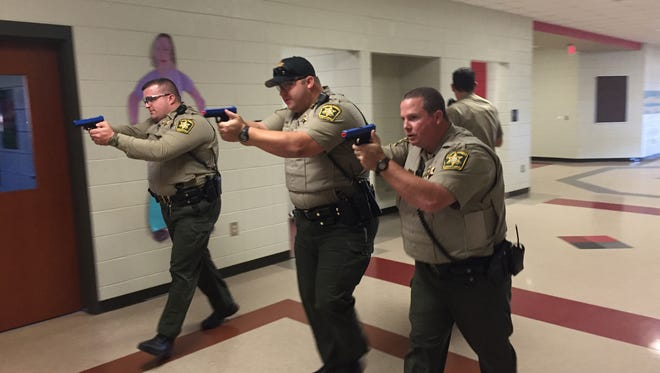 Pickens County deputies simulate targeting a gunman during an active shooter drill at Liberty High School in 2015. With some reports suggesting active shooter training has become more common in the wake of America's unique epidemic of mass shootings, the USC administration has placed an increasing priority on training faculty, staff and students to respond to an active shooter.