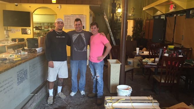 Business partners Murphy Jones and brothers Todd and Scott Spindler plan to open Ole Fire Grill in downtown Melbourne in February.