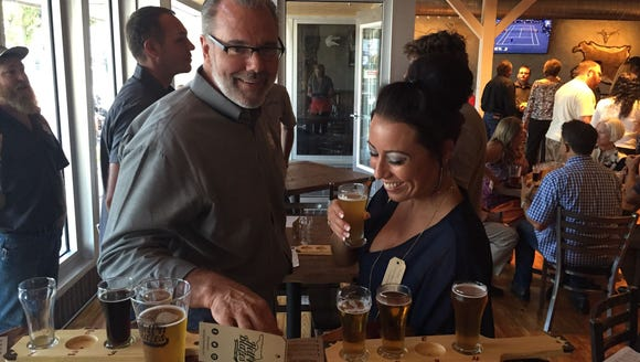 Hell 'n Blazes owner Don DiFrisco talks with brewery
