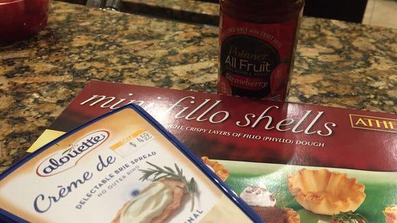 Brie Bite intredients: brie, mini-fillo shells, jelly.