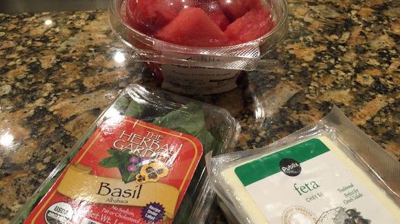Watermelon Feta Skewer ingredients: watermelon cubes, feta cheese, fresh basil.