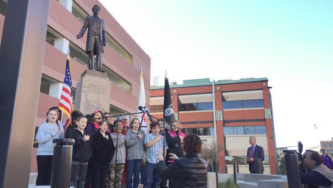 """Lincoln Elementary students sing """"God Bless America"""" on Friday, Nov. 11, during the rededication of the city's Abraham Lincoln statue."""