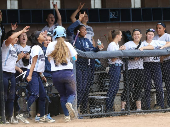 Immaculate Conception cheers after Jaden Farhat (back to camera) heads back to the dugout after scoring in the third inning. Immaculate Conception went on to beat Wildwood Catholic in the State Non-Public B Softball Championship in Union, 8-2, Sunday June 4, 2017.
