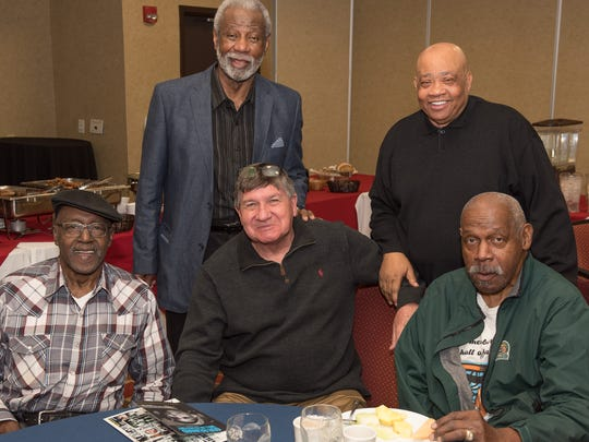 Orsten Artis, left to right, Nolan Richardson, Togo Railey, Willie Worsley and Willie Cager