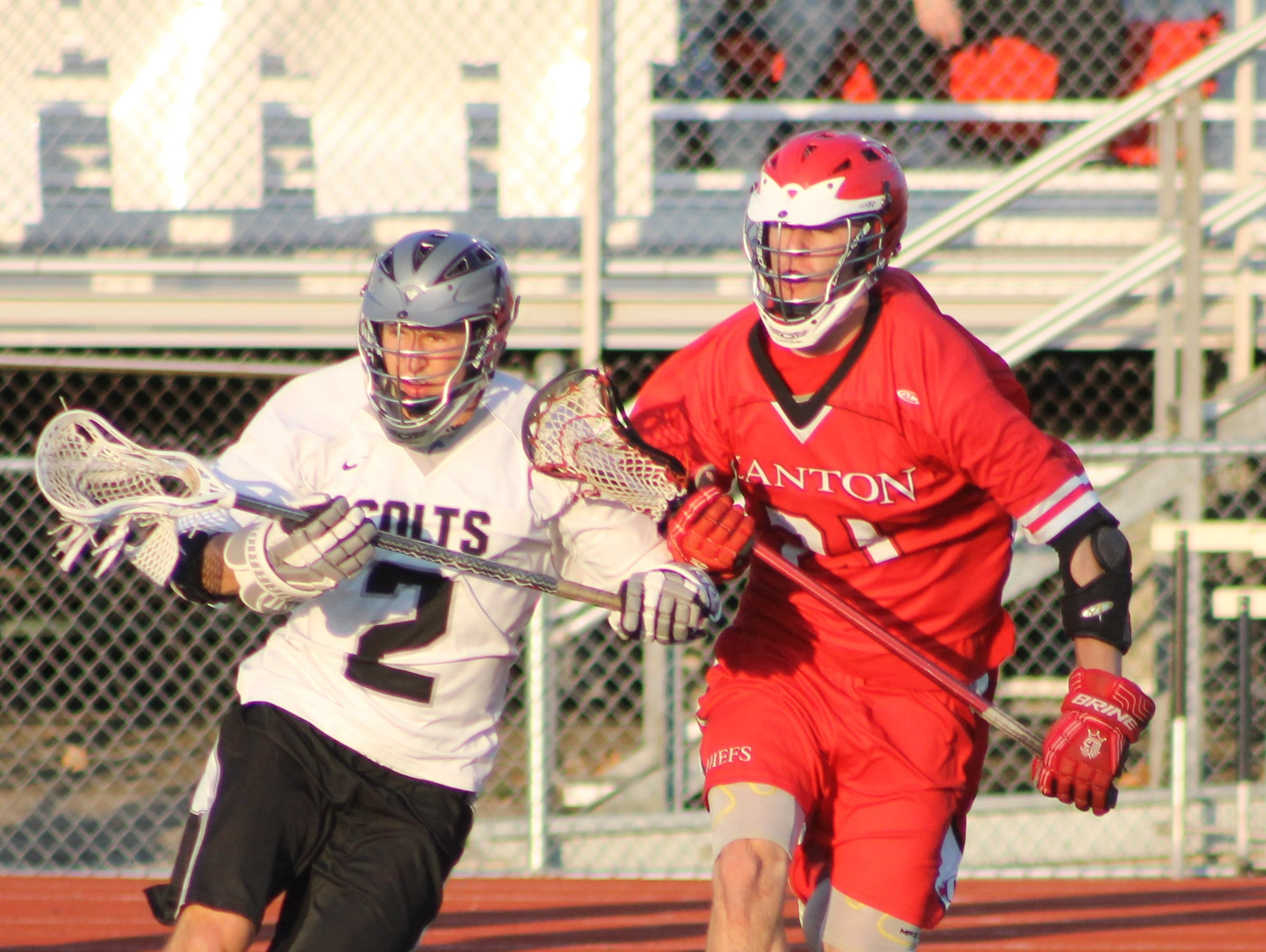 Shadowing each other during Thursday's Division 1 regional boys lacrosse contest are Troy's Andrew Hadad (No. 2) and Canton's Jay Krebs (No. 21).