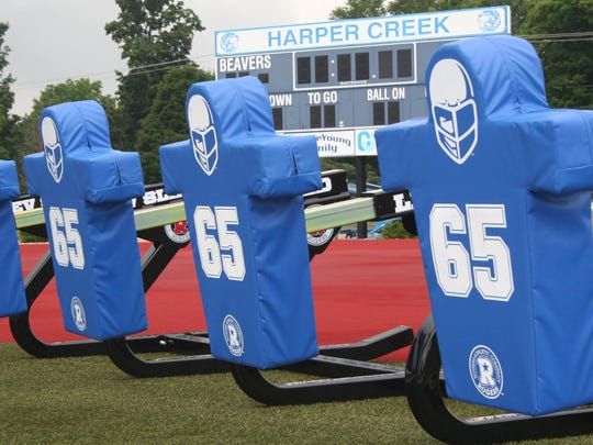 As a tribute to Chris Powell, a Harper Creek football player who died in a car accident in June, the program has chosen to put his number on one of the newest pieces of training equipment for the football team this fall -- a blocking sled.