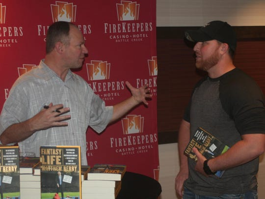 ESPN Fantasy Football expert Matthew Berry talks to a fan during the FireKeepers Fantasy Football event in Battle Creek on Saturday.