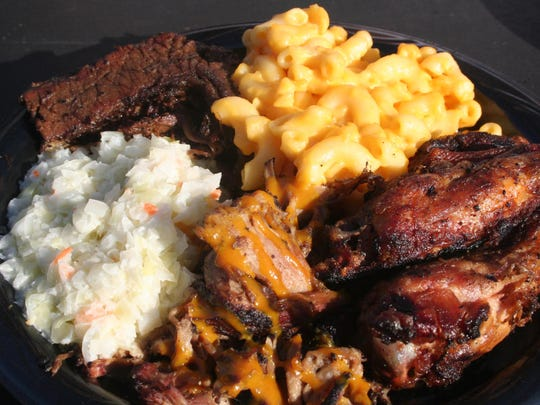From the BBQ Pit, where the smoke the food under the stands, the Kalamazoo Growlers offer brisket, pulled pork and chicken wings.
