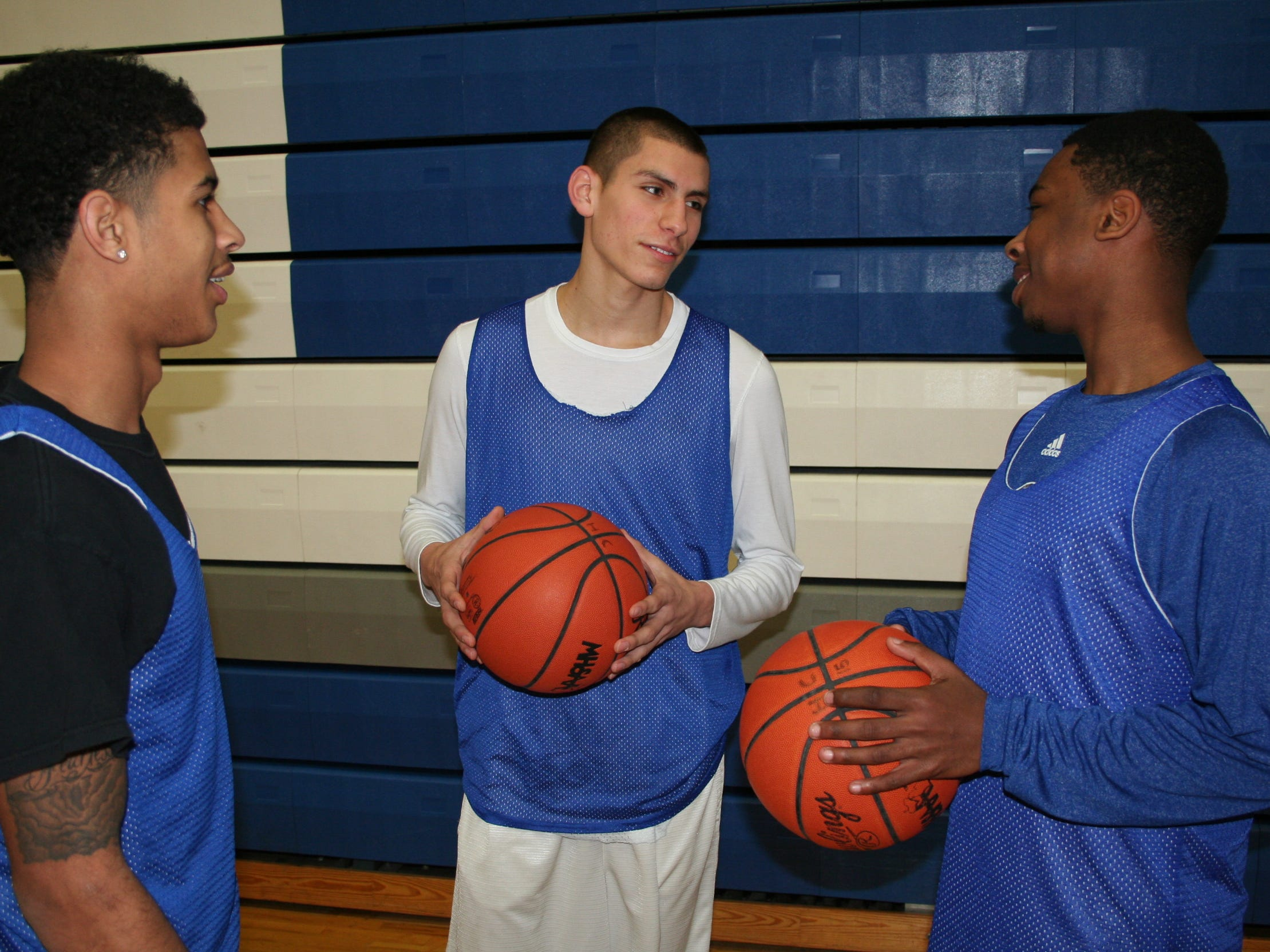 Harper Creek's triple threat at the guard position all average more than 16 points per game, led by, from right, Khylen Watkins, James Cadena and TraVon Johnson.