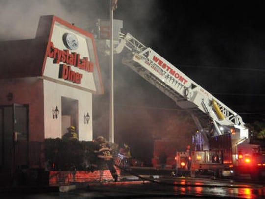 The former Crystal Lake Diner in Westmont burns in June 2014.