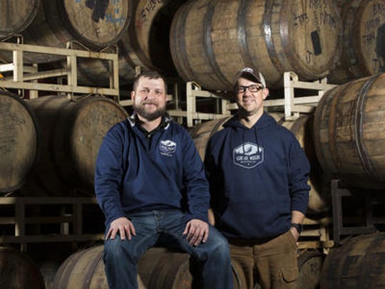 Central Waters Brewing Co. President Paul Graham (right, shown with co-owner Anello Mollica) says the Portage County beer-maker already stands to lose $20,000 because of the U.S. government shutdown and it could cost more.