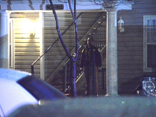 Police investigate at Vinings apartments in Bear on Monday night. Two are dead in the incident.