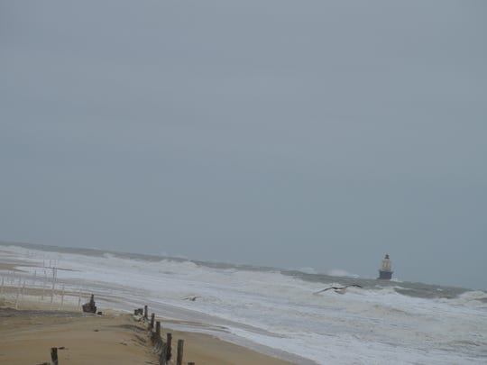 A dune overwash at Cape Henlopen Point. The outer breakwater light is in the distance.