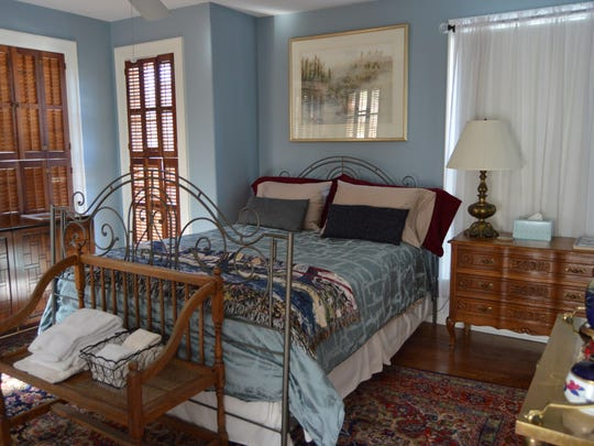 """The """"blue room"""" is decorated with antique and statement"""