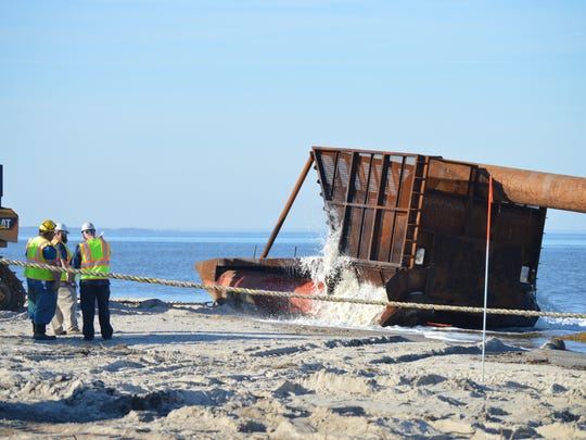 A pipeline at the north end of Fowler Beach Road is primed with water prior to the start of sand pumping. Oct. 21, 2015.