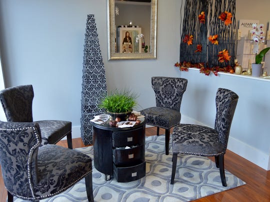 Tatum used plush chairs and simple, yet elegant pieces to decorate his salon's reception area.