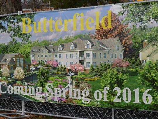 A banner touting the Butterfield project hangs from