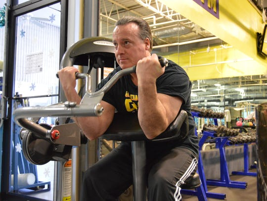 Tim Fell exercises at Gold Coast Gym in Ocean City.