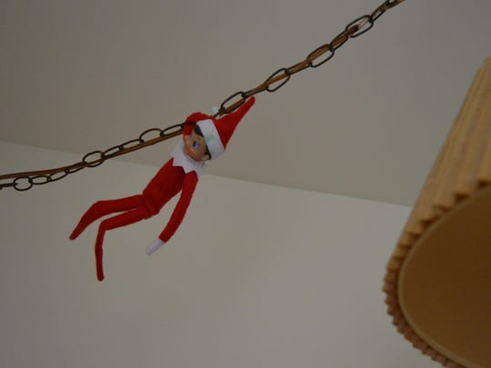 Snowflake the Elf hangs from the light fixture.