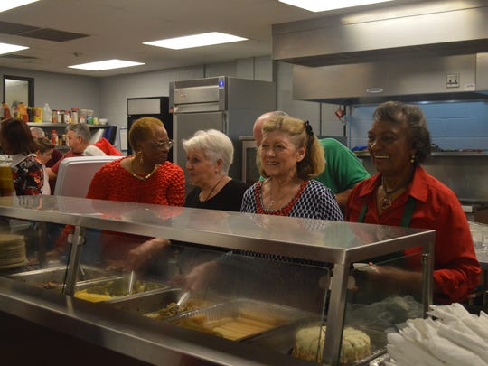Volunteers help serve food to the crowd gathered at RIFA on Christmas Day.