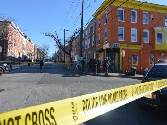 Police investigate reports of a shooting at West Fifth and North Madison streets Sunday.
