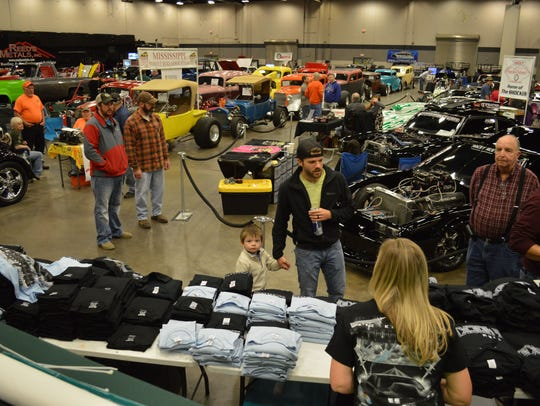 A crowd gathers to look at cars at the 2016 Racing Vehicle Extravaganza.